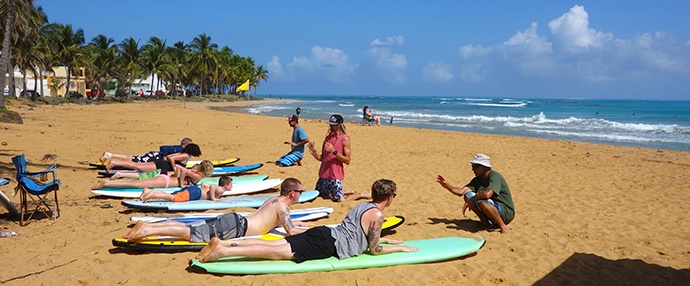Teaching surfing on Luquilo Beach