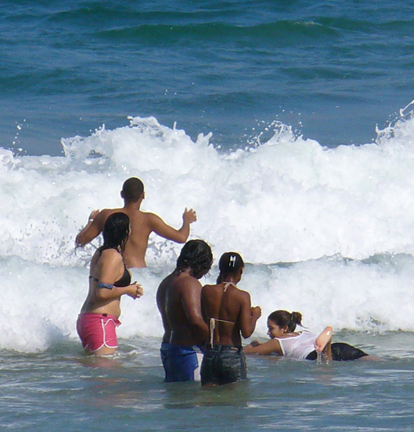 swimming at Luquillo beach in the surf.